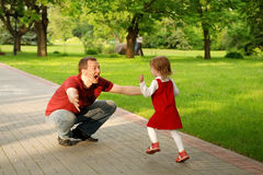 Man playing with little girl Stock Photos