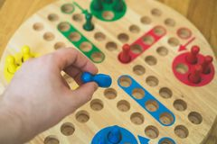 Man playing Ludo board game. Close-up view Royalty Free Stock Image