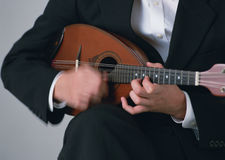 Man playing Mandolin on dark background Royalty Free Stock Images