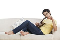 Man playing mandolin Stock Images