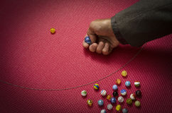 Man playing marbles Royalty Free Stock Photo