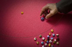 Man playing marbles Stock Photo