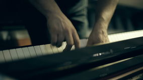 A man playing a melody on the piano stock footage