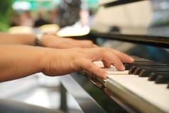 Man playing melody on piano. Man hands playing melody on piano close up Royalty Free Stock Image