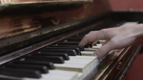 Man playing melody on piano by both hands. Professional musician. Talent. Black and white keys. stock video footage