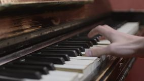 Man playing melody on piano by one hand. Musician. Talent. Song. Black and white keys. stock video footage