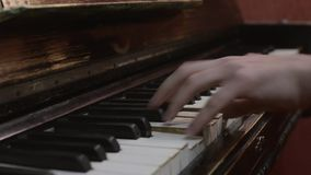 Man playing melody on retro piano. Musician. Talent. Song. Black and white keys. stock footage