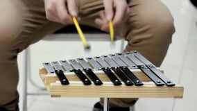 A man is playing on a metalophone stock video footage