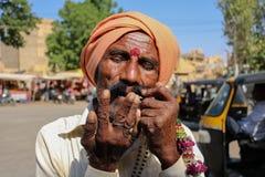 Man playing mouth harp at Mehrangarh Fort, stock photos