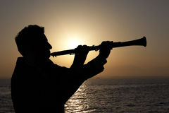 Man playing on oboe Stock Photo
