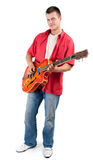 Man playing on orange electric guitar Stock Photography
