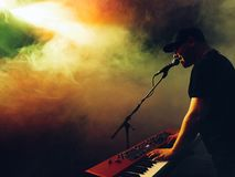 Man Playing Organ While Singing With Smoke Around Royalty Free Stock Photography