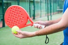 Man playing paddle tennis Stock Image