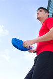 Man playing paddle tennis Stock Photography