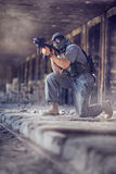 Man playing paintball Stock Image