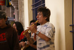 Man playing pan pipes Stock Photo