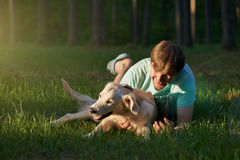 Man playing with pet Golden Retriever Stock Photo