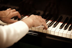 Man playing piano. Close up of male hands playing piano. Horizontal shape, copy space Stock Photo