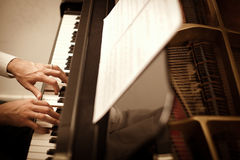 Man playing piano. Close up of male hands playing piano. Horizontal shape, high angle view Royalty Free Stock Photography