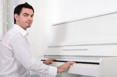 Man playing piano Stock Photos