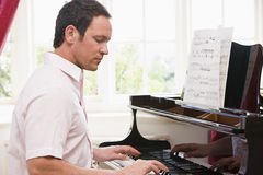 Man playing piano Stock Photography