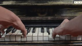 Man playing piano by both hands. Musician. Talent. Melody. Black and white keys. stock footage