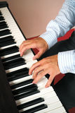 Man playing piano. Close up hand practicing piano Royalty Free Stock Photos
