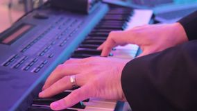 Man is playing the piano. Close up stock video footage