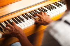 A man playing piano, closeup shot Stock Photos