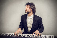 Man playing piano Stock Image
