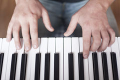 The man playing the piano. Hands closeup on the keys of the piano Stock Photo