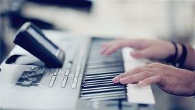 Man playing the piano keyboard stock video