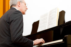 Man playing the piano Stock Photos