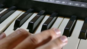Man playing the piano synthesizer hand run over stock video footage