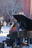 Washington Square Park, Man Playing the Piano, New York City. A man playing the piano in Washington Square Park, New York CIty stock images