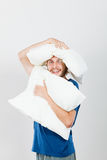 Man playing with pillows, good sleep concept Royalty Free Stock Photo
