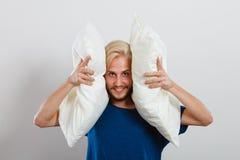 Man playing with pillows, good sleep concept Royalty Free Stock Photos