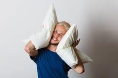 Man playing with pillows, good sleep concept Stock Photography
