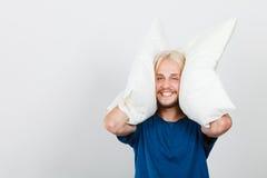 Man playing with pillows, good sleep concept Stock Photo
