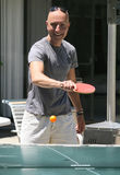 A man playing ping-pong Stock Photography