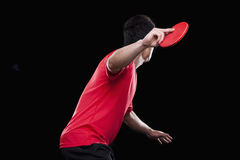 Man playing ping pong, black background Stock Photos
