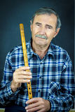Man playing on pipe flute Stock Photography