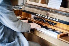 Man playing a Pipe Organ Stock Image
