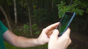 Man playing Pokemon GO application the hit augmented reality smart phone app while trying to catch Pokemon. stock footage