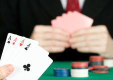 Man playing poker Stock Images