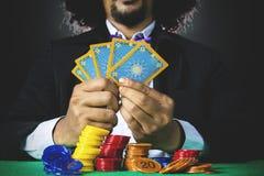 Man playing poker cards in gambling Royalty Free Stock Photo