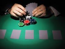 Man playing poker on green background. Stock Image