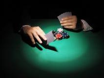 Man playing poker on green background. Stock Photo