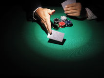Man playing poker on green background. Stock Photography