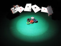 Man playing poker on green background. Stock Images